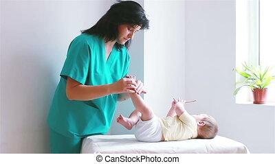 massaging little baby boy foot