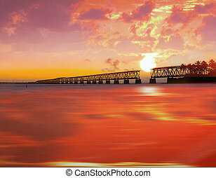 Beautiful colorful sunset or sunrise with broken bridge and...