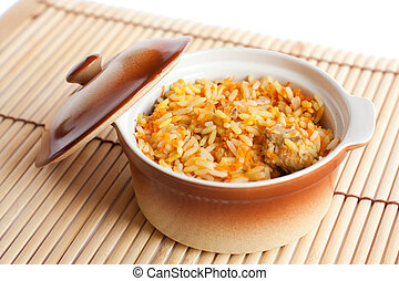 Freshly prepared Asian risotto with beef Isolated on white...