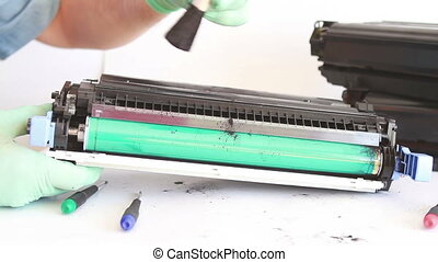 hands cleaning toner cartridge with brush the dust. worker...