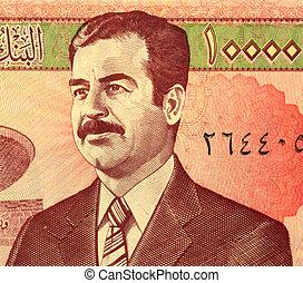 Saddam Hussein on 10,000 dinars banknote from Iraq