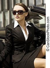 businesswoman in a cabrio - attractive brunette...