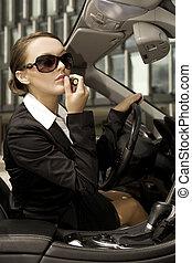 businesswoman in a cabrio - attractive brunette...