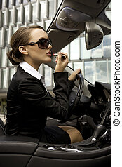 businesswoman in a cabrio - attractive and young...
