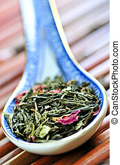 Loose green tea - Green tea loose dry leaves in a spoon