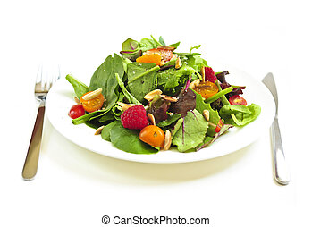 Plate of green salad on white background - Plate of fresh...
