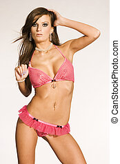 woman in pink lingerie - beautiful brunette girl in pink...