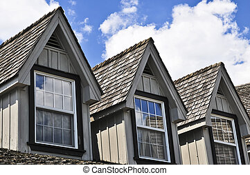 House detail - Window dormers on a house with wooden...