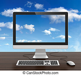 Computer monitor with keyboard and mouse on desk and cloudy...