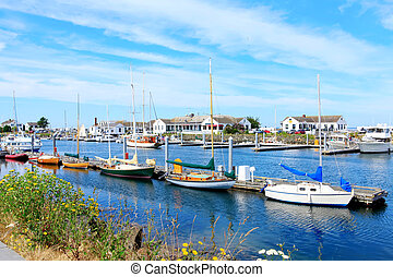 Port Townsend, WA. Downtown marina with boats and historical...