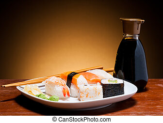 Sushi - still life with fresh sushi and bottle of soy sauce