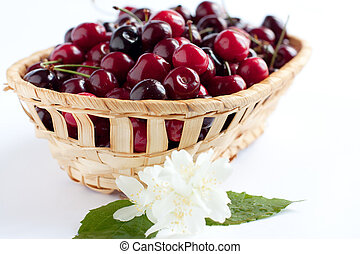 Wooden basket with juicy cherries Lot of tasty cherry