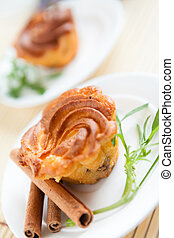 brown cupcake on a white plate, two