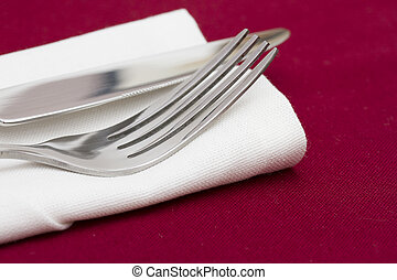 Cutlery on white folded napkin