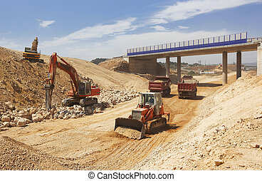 High speed line under construction with trucks, tractors and...