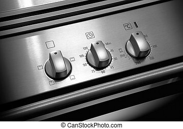 Oven knobs on metallic structure black and white
