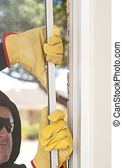 Burglar breaking through window of home - Male intruder with...