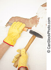 Interior House wall renovation hammer and chisel