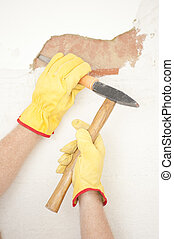 Interior House wall renovation hammer and bite