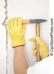 Interior House wall renovation hammer and gouge - Workers...