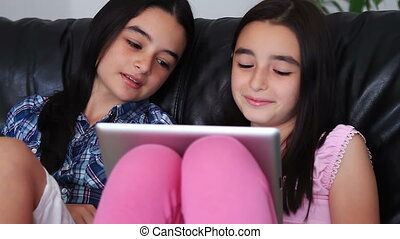teenage girls have fun on tablet pc - Happy teenage girls...