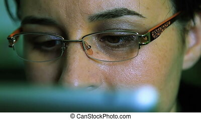Young woman working on a tablet pc - Young woman with...