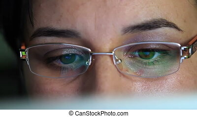 Young woman working on tablet pc - Young woman with glasses...