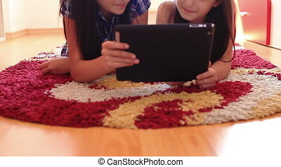 happy teenage girls using tablet pc - Two happy teenage...