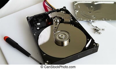Data recovery concept - Technical surgeon working on hard...