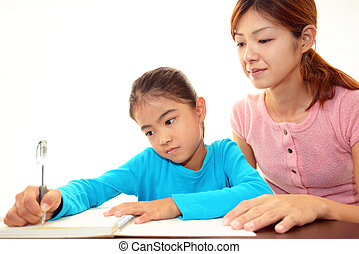 Child studying at the desk - Mother with child studying.