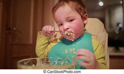 Boy is having dinner. - Two year old boy is having dinner...