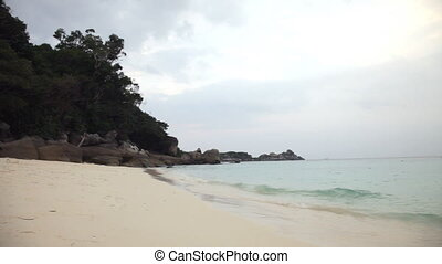 Rising tide on a sand beach, Similian Islands, Thailand