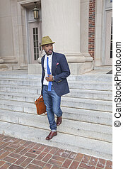 A stylish young professional - A fashionable young African...