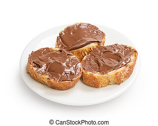 baguette slices spread with nut-choco paste on plate,...