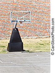 Basketball hoop court - Basketball hoop and an empty outdoor...