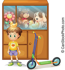 A young boy with his scooter and his toys in a cabinet