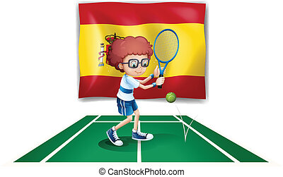 A boy playing tennis in front of the flag of Spain