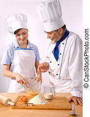 chef couple - A male and female chef on the white background