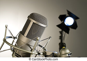 Microphone in studio - Microphone in studio on a light...
