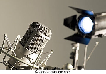 Microphone in studio. - Microphone in studio on a light...