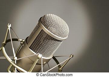 Microphone in studio. - Microphone in studio on a light...