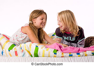 Happy when tickling - Two young children enjoying their...