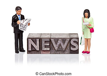 NEWS word in letterpress with miniature people reading