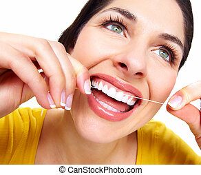 Beautiful woman with a dental floss Dentist health care...
