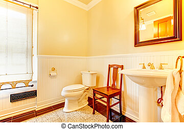 Simple old antique bathroom with chair.