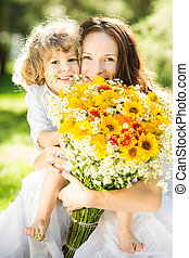 Happy family with spring flowers - Happy family with big...