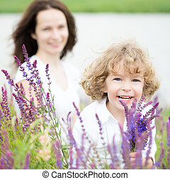 Mothers day - Happy child with bouquet of spring flowers...