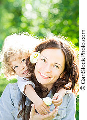 Mothers day - Child and young woman with flowers playing in...