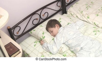 boy sleeps in the nursery.