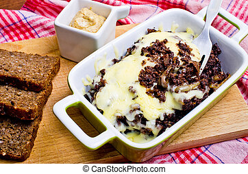 Casserole made for black pudding with onion, garlic and...